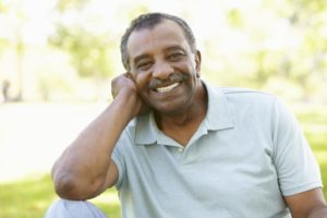 older man smiling full set teeth