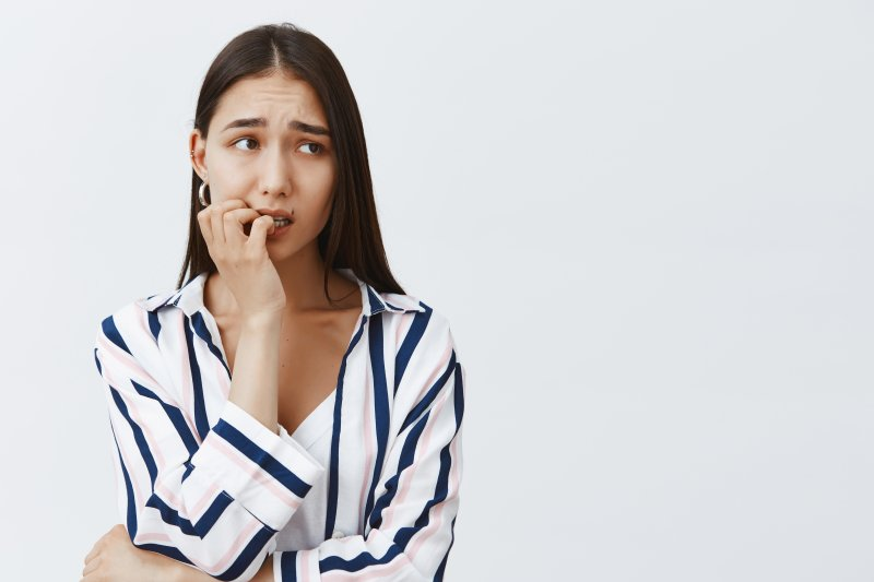 young woman experiencing dental anxiety